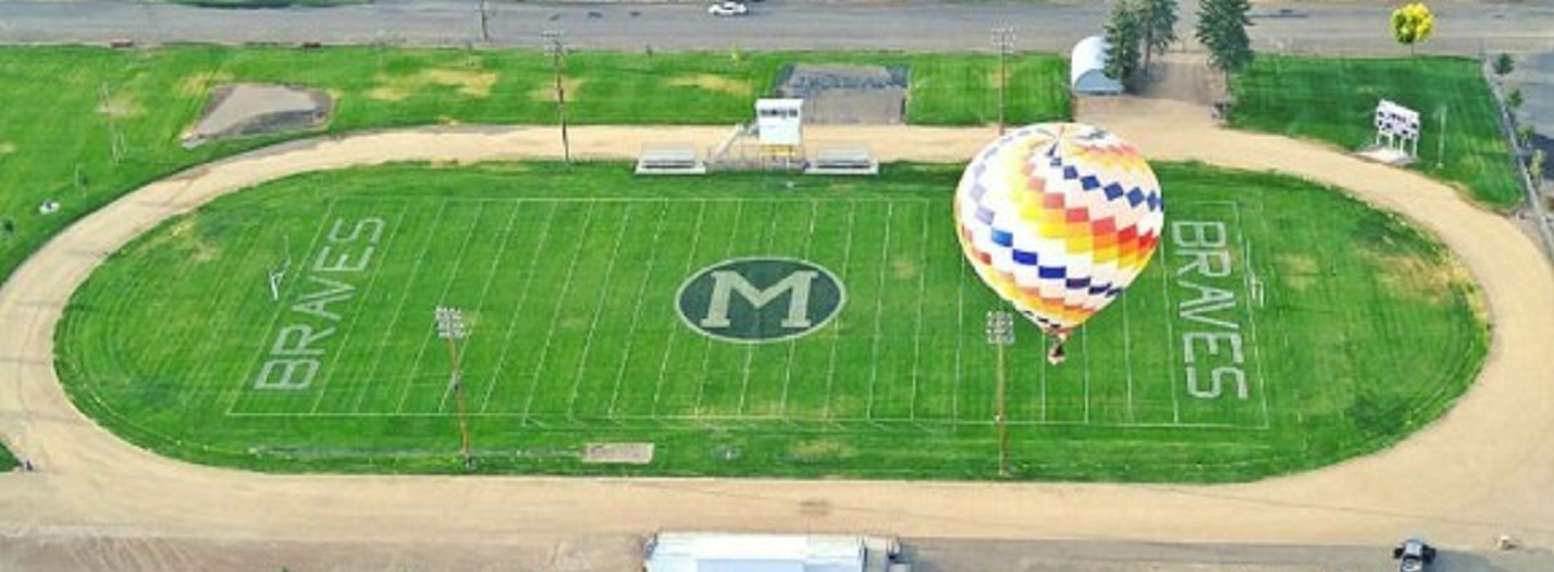 aerial view of football field with hot air balloon